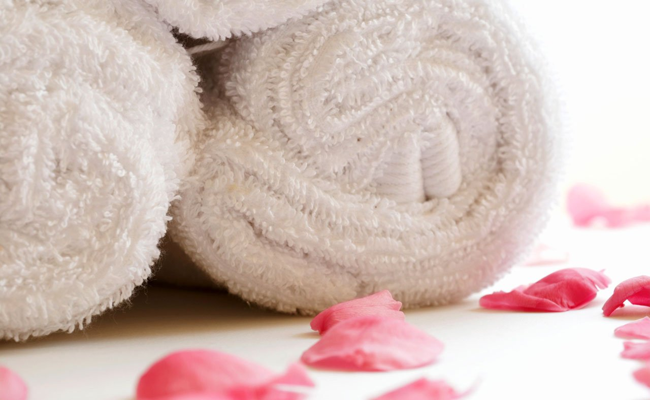 White towels in every bathroom for home staging