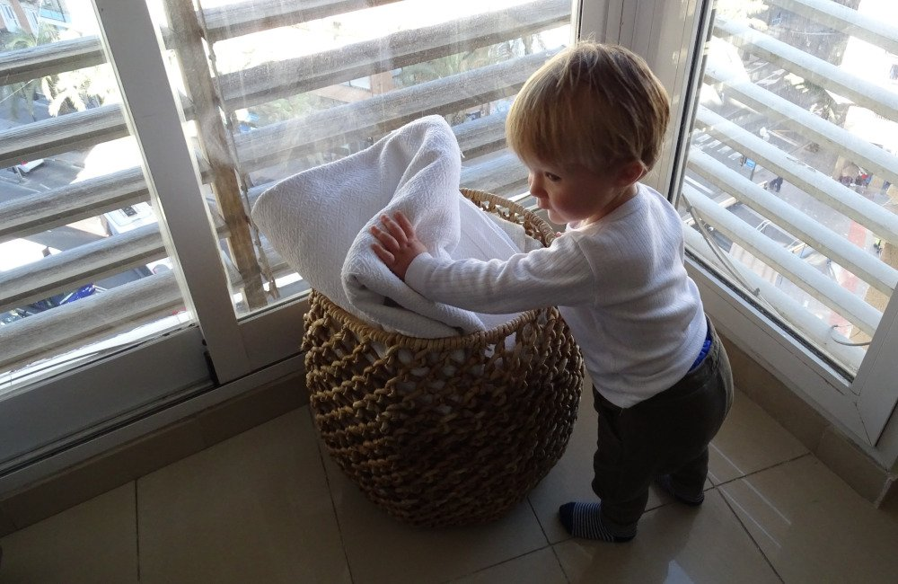 Toddler and basket for blankets